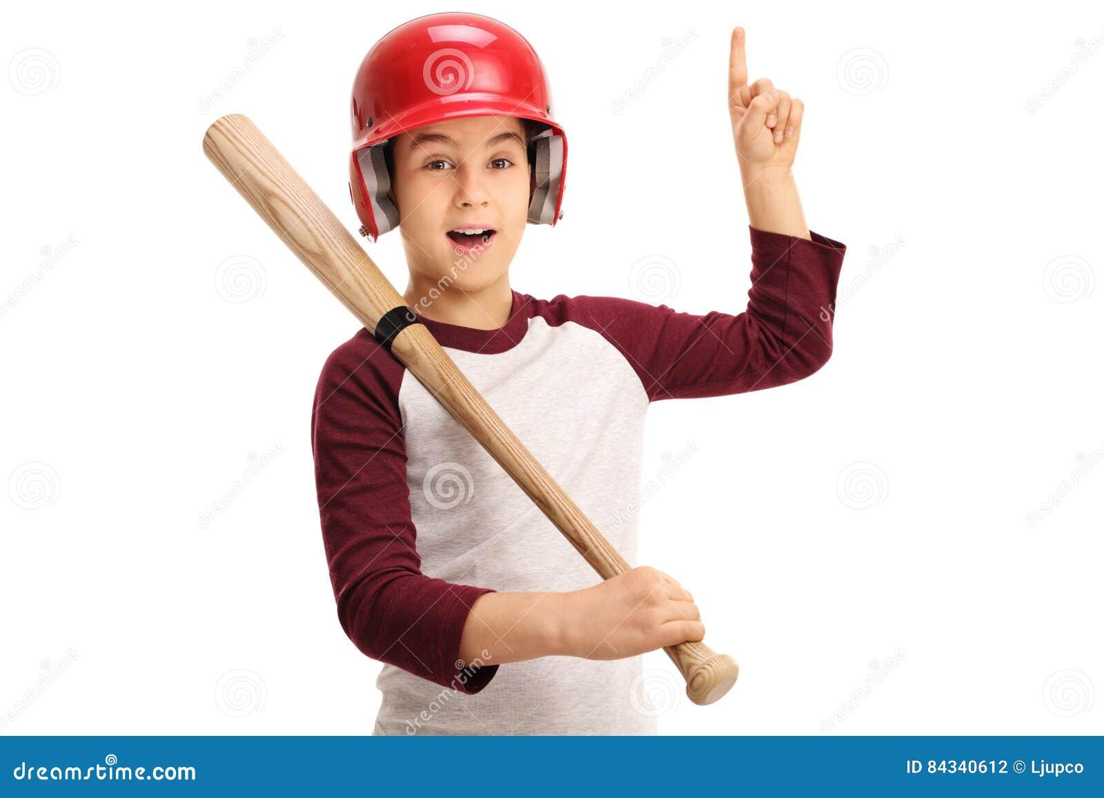 joyful kid with baseball equipment pointing up stock photo image