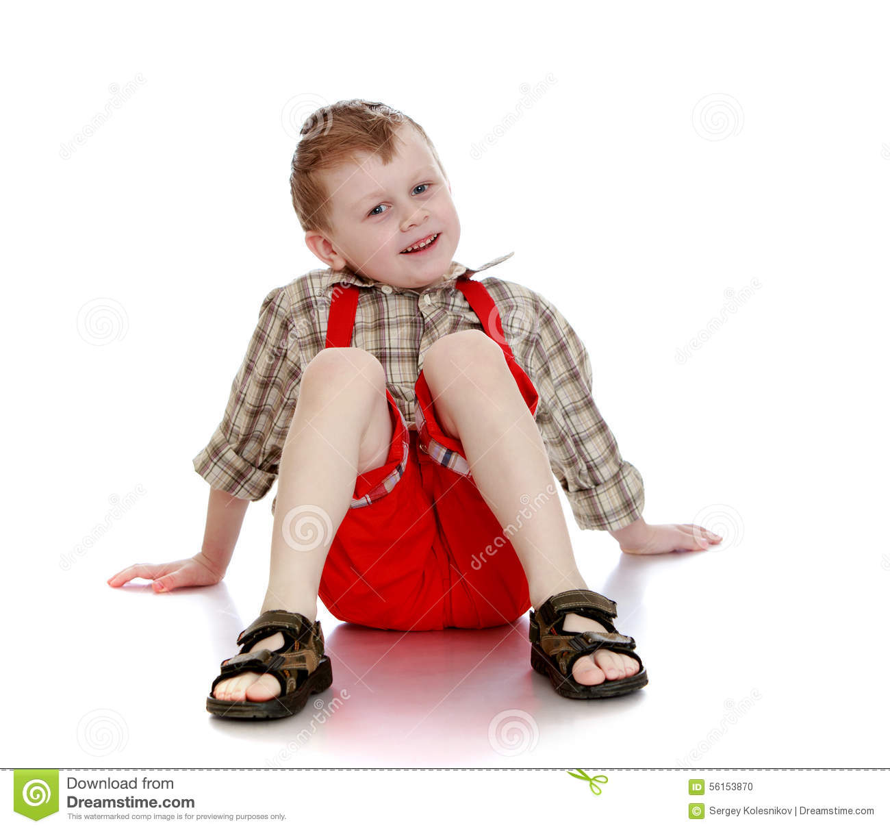 d4a5a7dca Joyful little boy in a plaid shirt, red shorts and flip-flops sitting on  the floor spreading their arms - isolated on white background