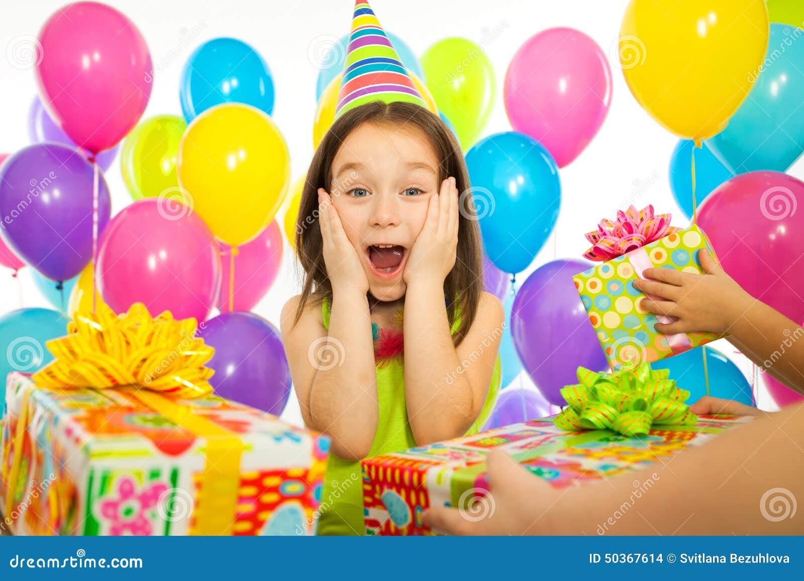 Joyful Little Kid Girl Receiving Gifts At Birthday