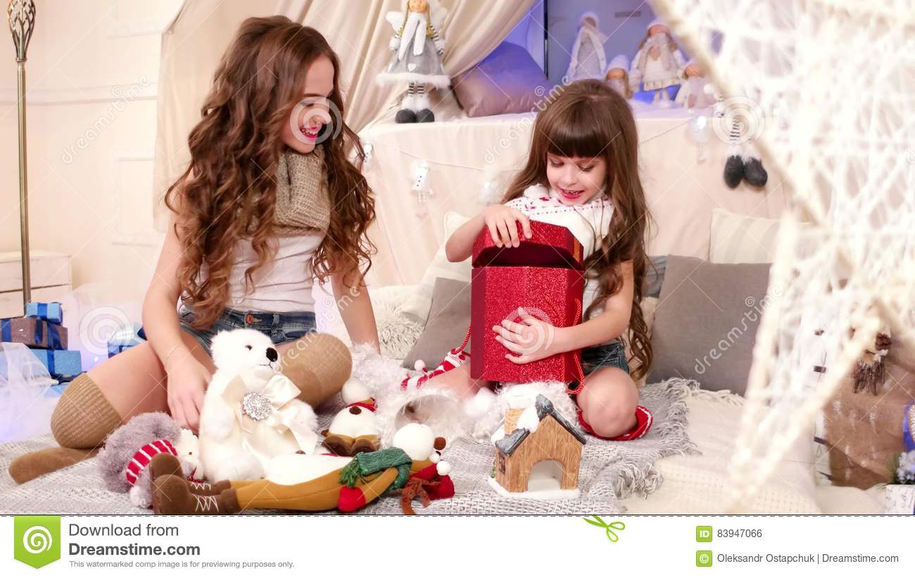 joyful moment of giving gifts older sister gives a christmas gift youngest family celebrating christmas eve happy stock footage video of lights