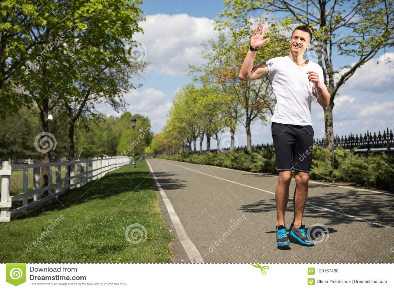 Smiling Man Is Waving Hand To Somebody In Hop Stock Photo Image Of