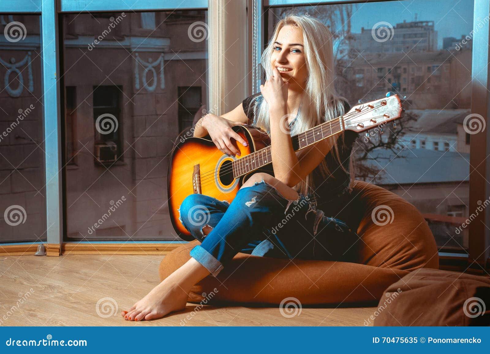 joyful young blonde girl plays guitar stock image image of blonde