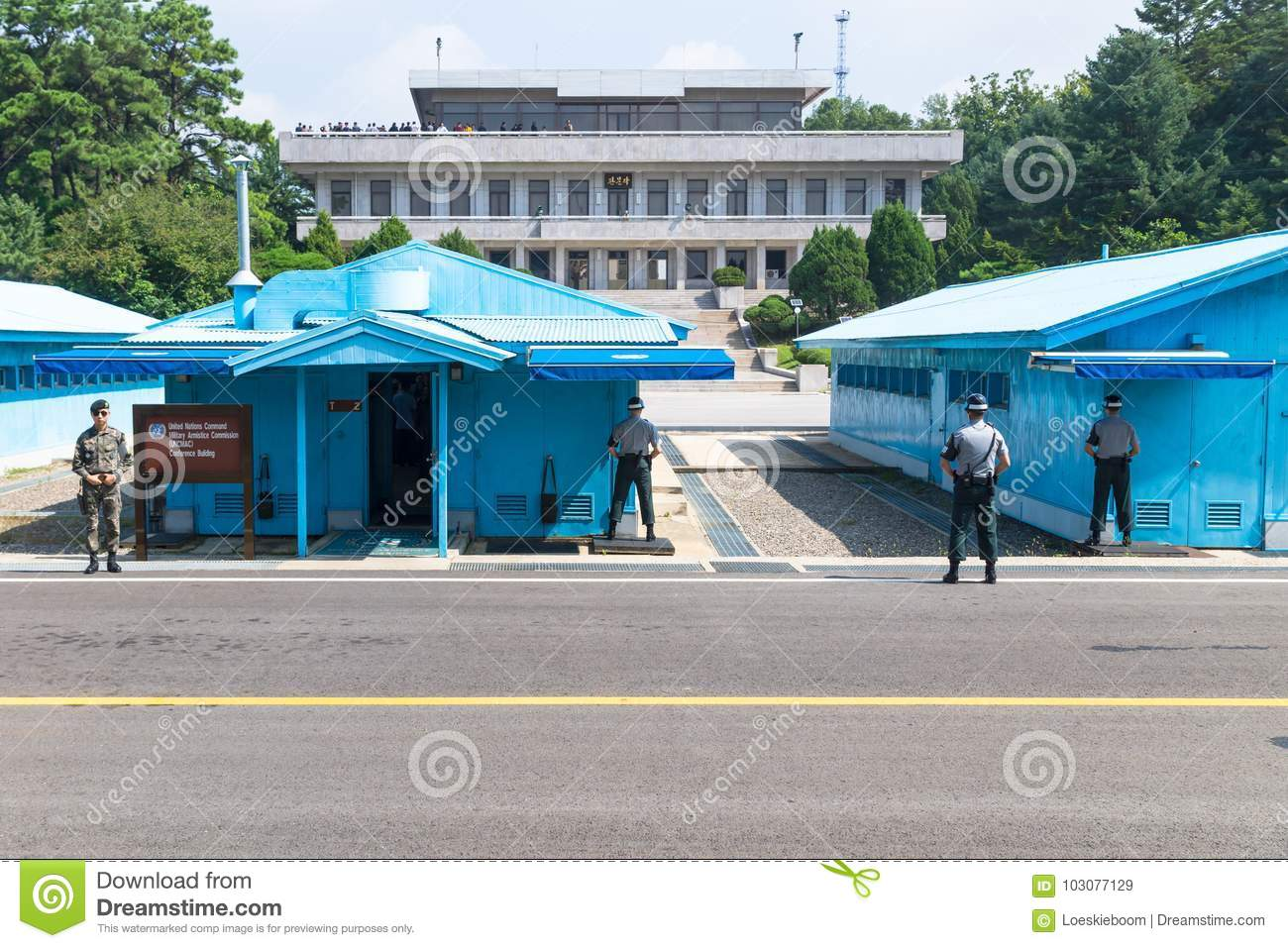 JSA within DMZ, Korea - September 8 2017: UN soldiers and soldiers on a sunny day in front of blue buildings at North South Korean