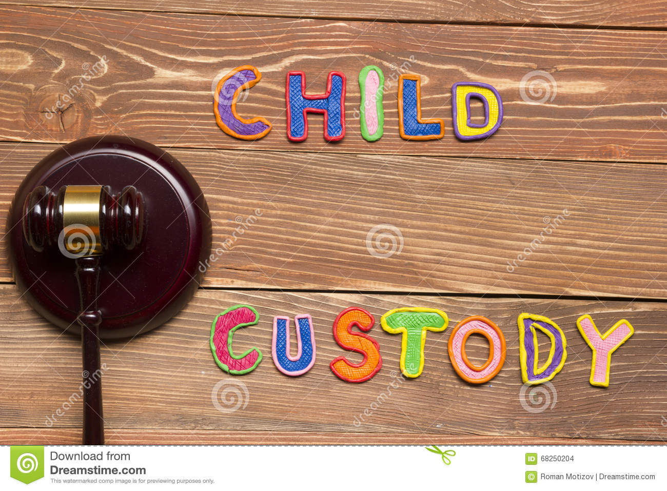 Judge gavel and colourful letters regarding child custody, family law concept.