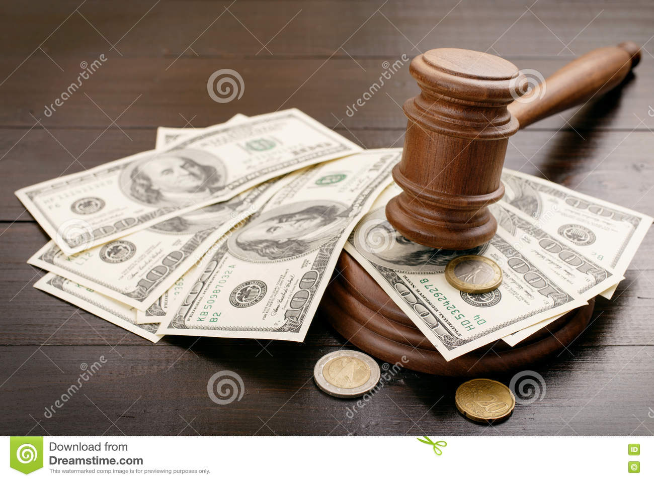 Judge gavel with dollars and euro cents