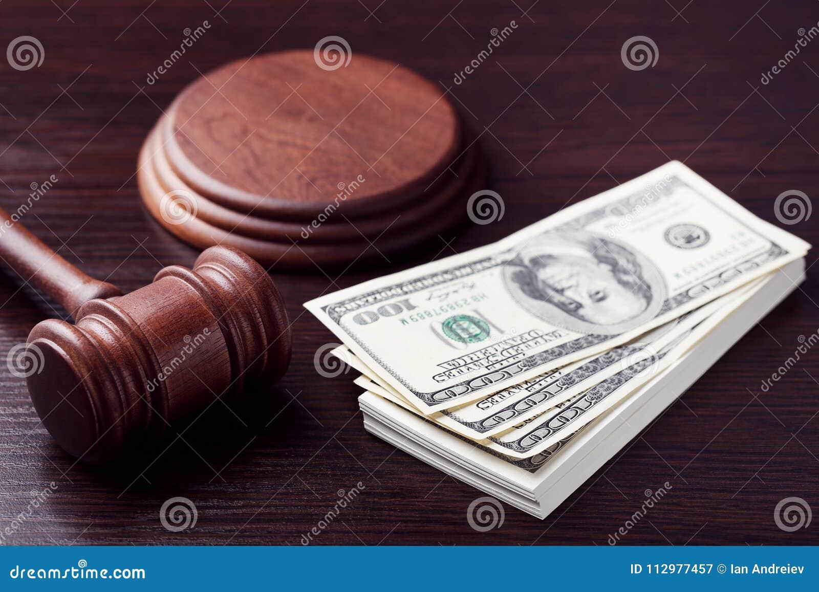 Judge gavel with dollars