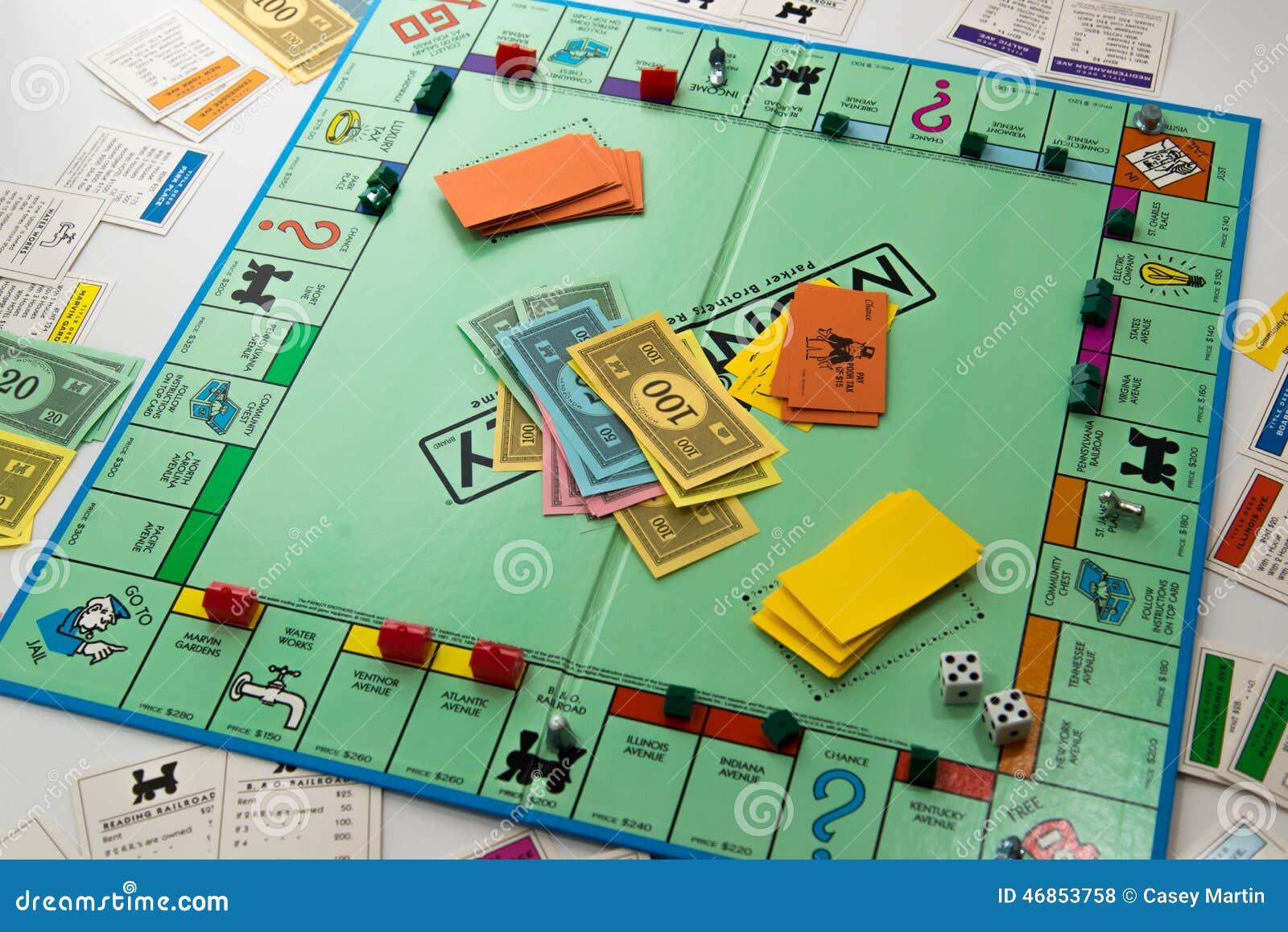 Juego de mesa del monopolio en juego foto de archivo for Formula d juego de mesa