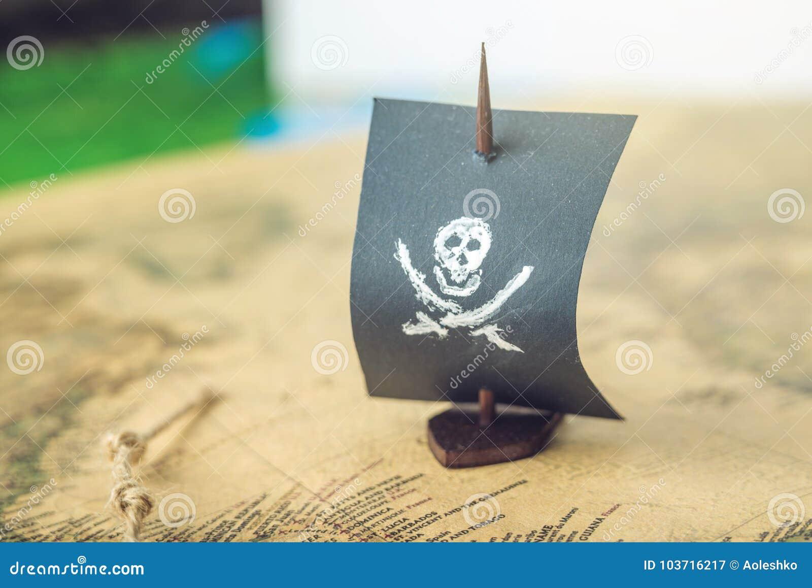 Juegue El Craneo Y Los Huesos De La Bandera De Pirata Del Barco En