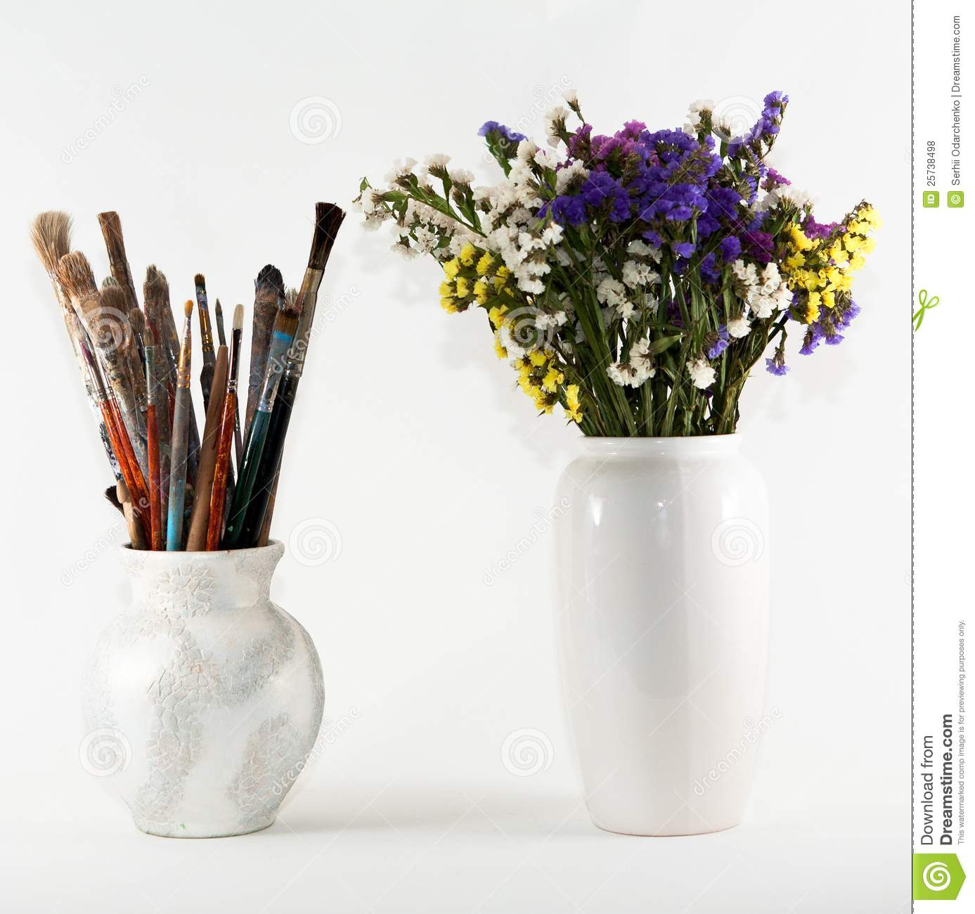 Jug with brushes and vase of wild flowers