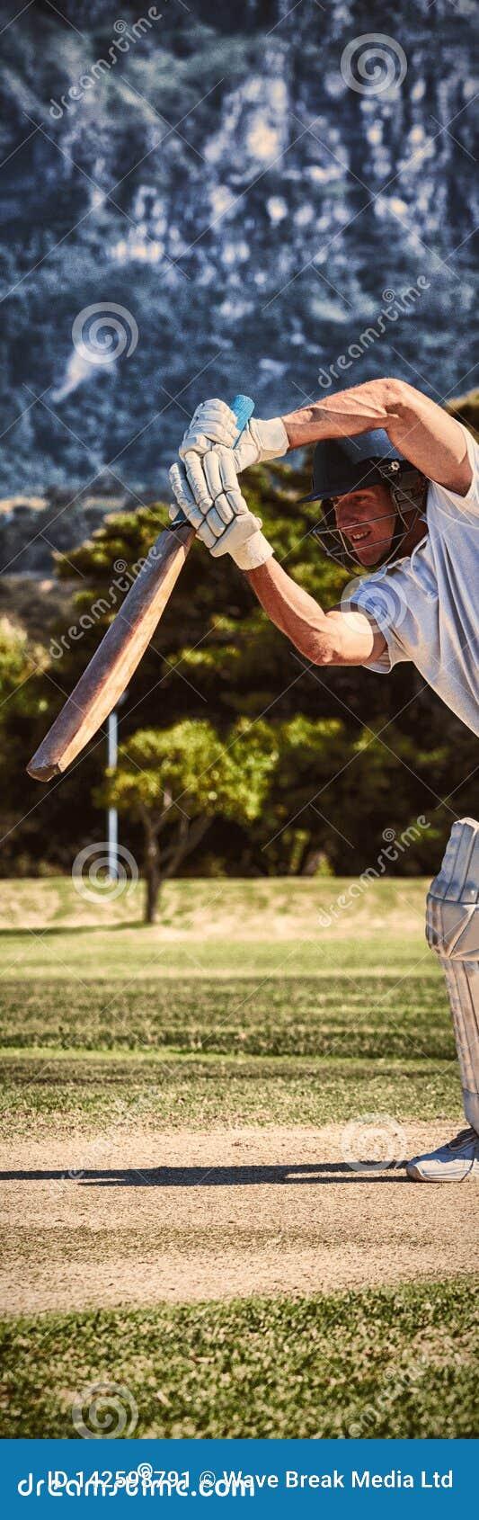 Jugador del grillo que juega en campo durante día soleado