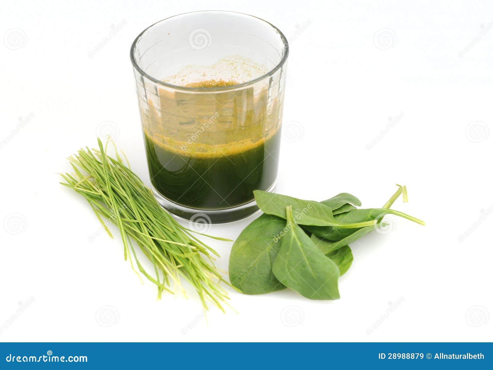 Jugo verde sin procesar de la hierba de la espinaca y del trigo