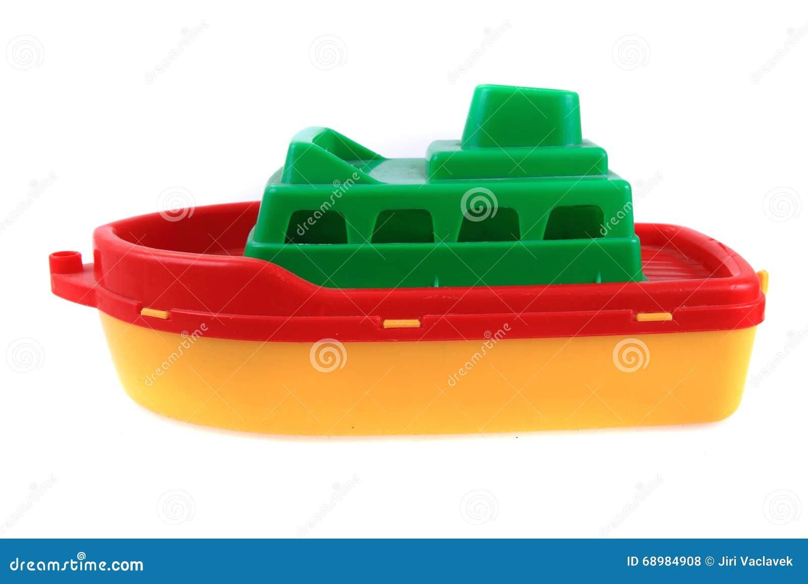 Juguete plástico de la nave del color