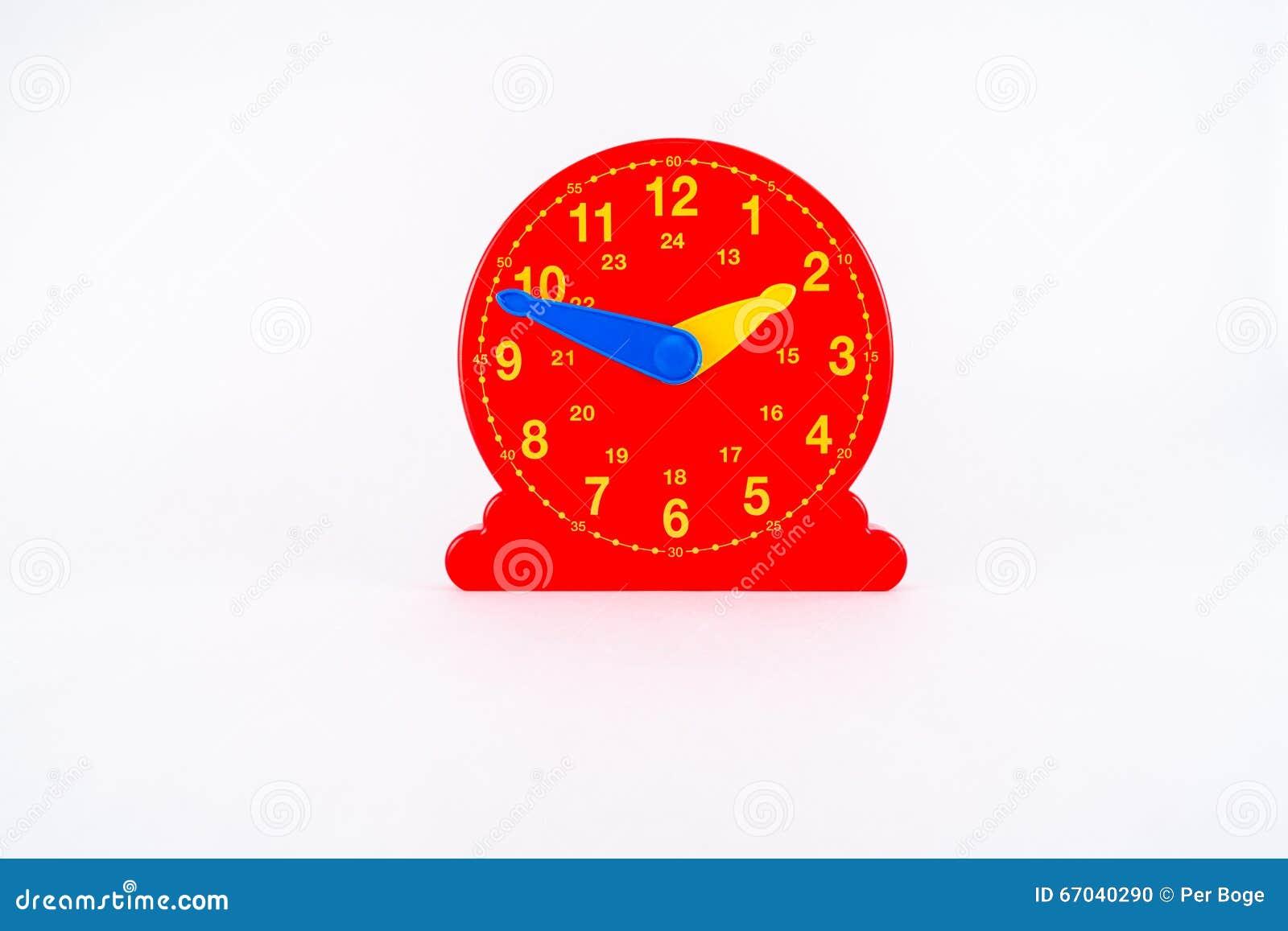 Juguete plástico rojo aislado del reloj por tiempo de aprendizaje