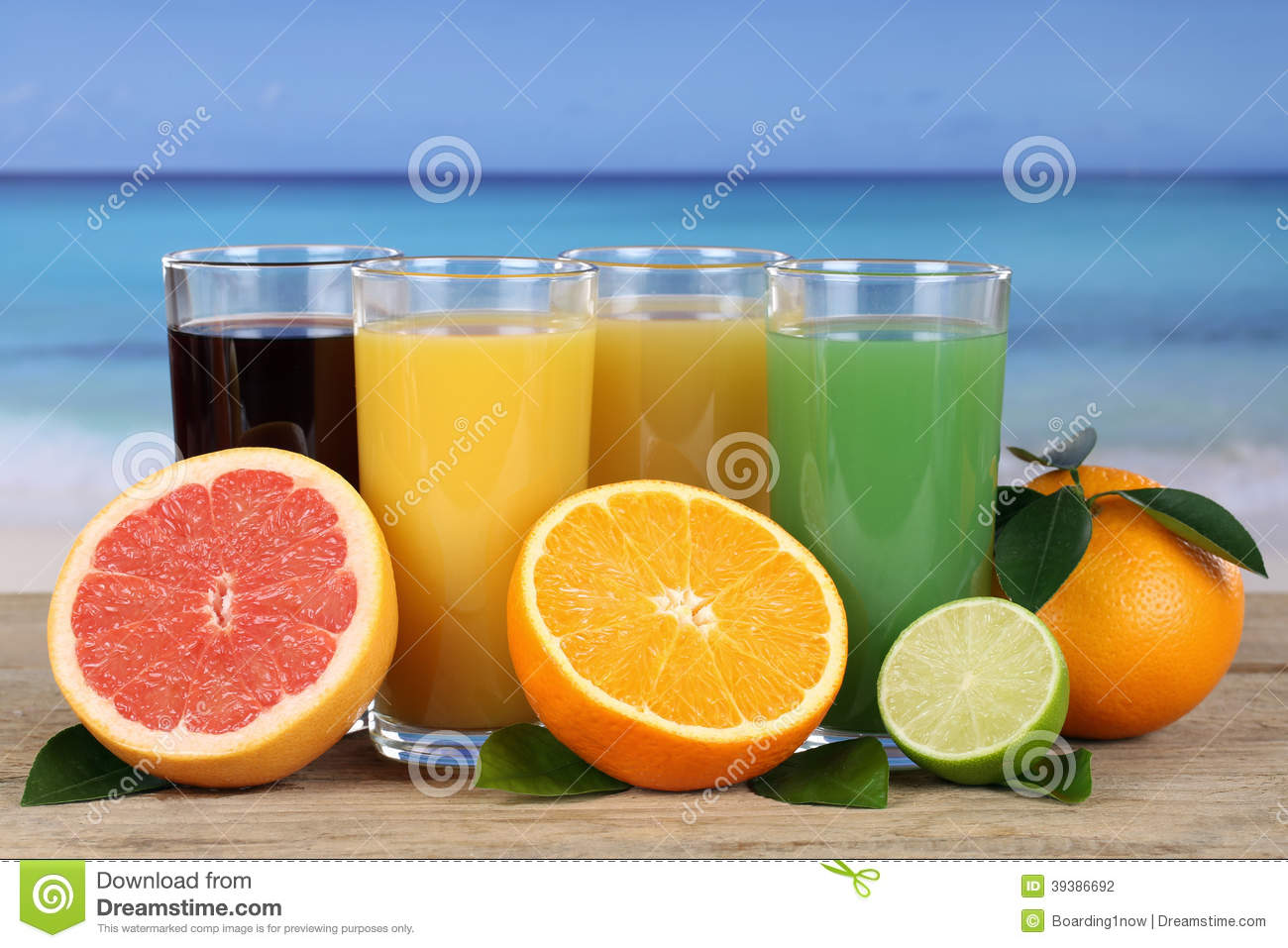 Juice from oranges and grapefruit on the beach