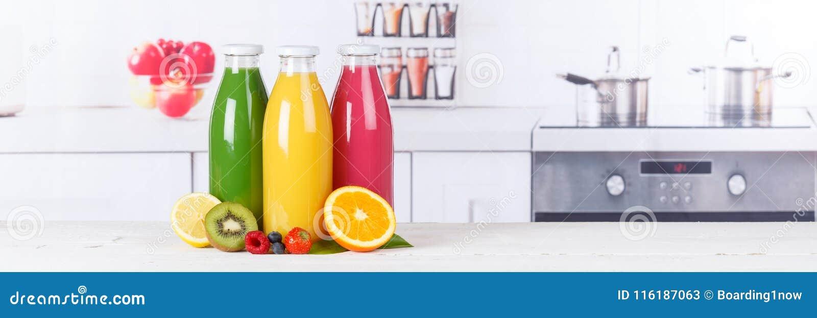 Juice smoothie orange smoothies in kitchen copyspace banner bottle fruit fruits