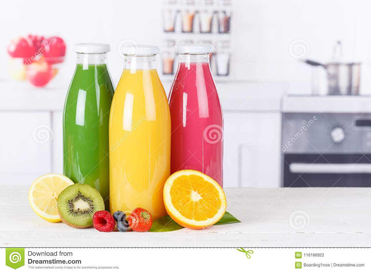 Juice smoothie orange smoothies in kitchen copyspace bottle fruit fruits