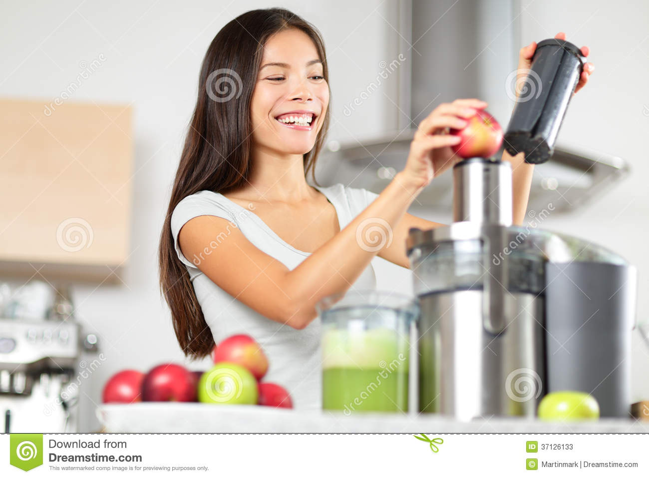 Juicing - Woman Making Apple And Vegetable Juice Stock ...