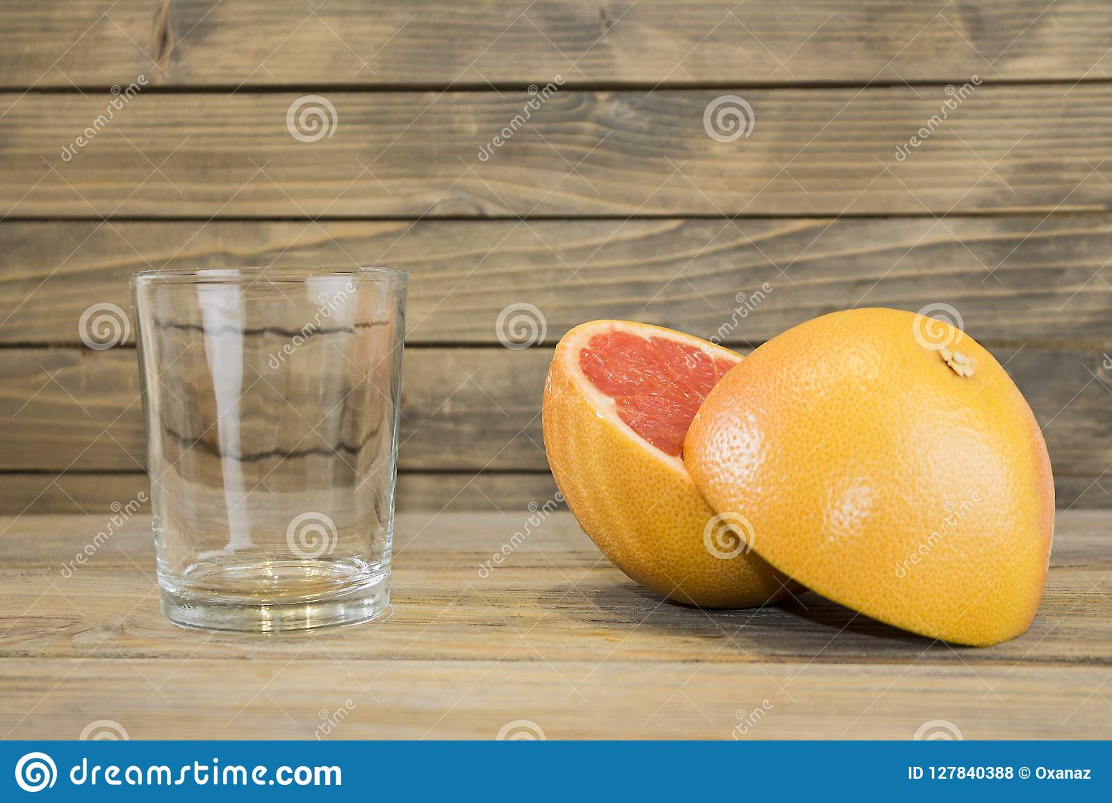 Juicy grapefruit close up view on wooden background