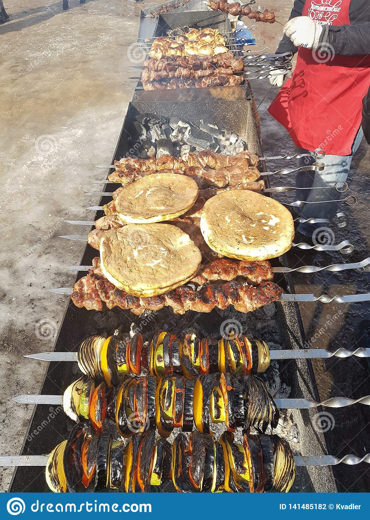 Juicy marinated in spices meat kebab on skewers, cooked and fried on a fire and charcoal barbecue grill, in the nature of snowy