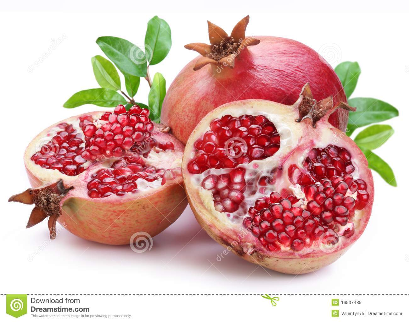 Juicy opened pomegranate with leaves.