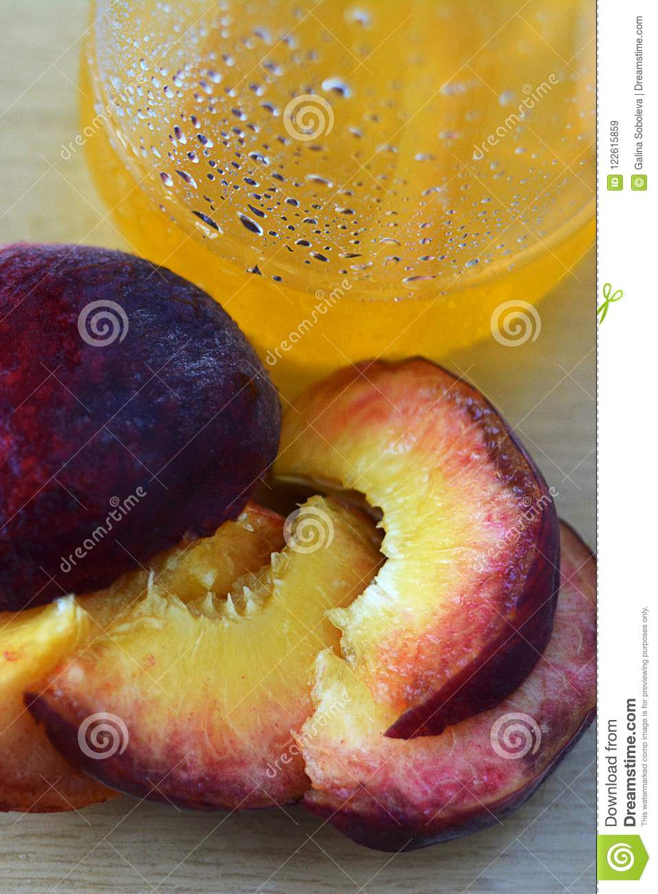 Juicy peaches of peach and a glass with peach juice.