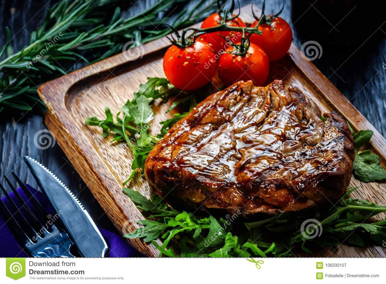 Juicy portions of grilled fillet steak served with tomatoes and