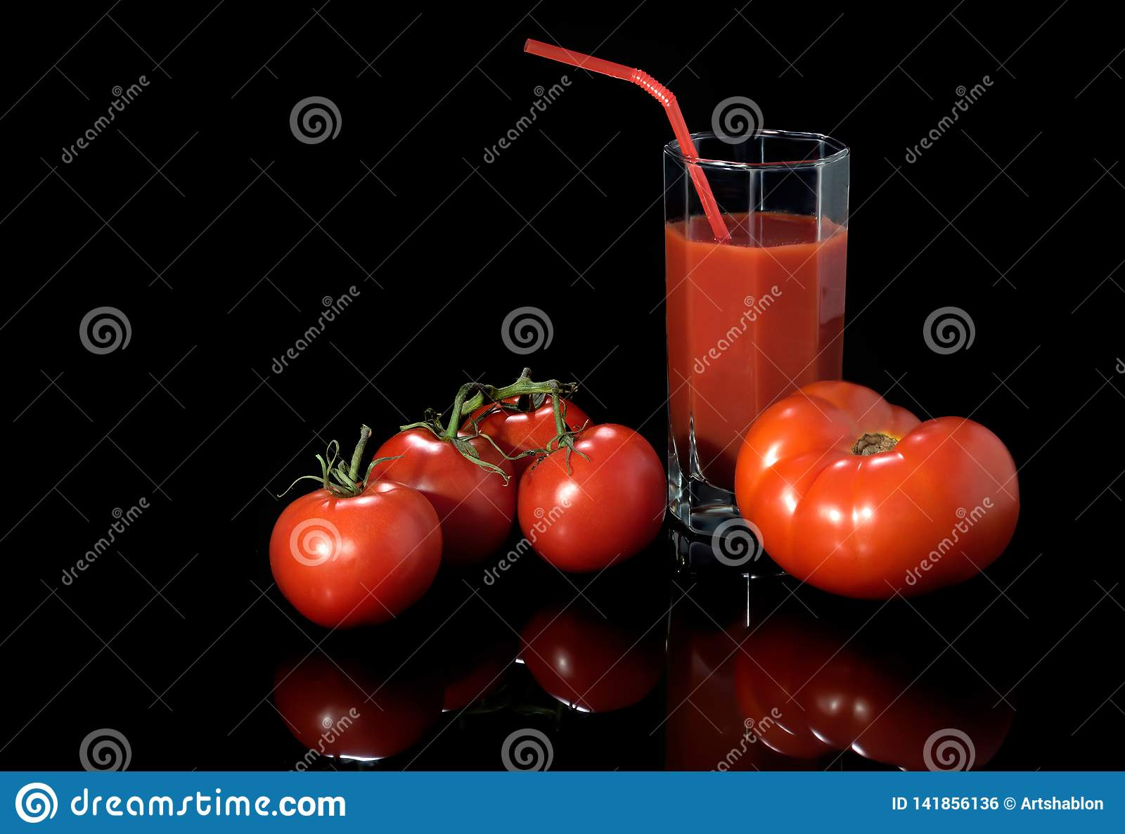 Juicy red tomatoes are isolated on a black background