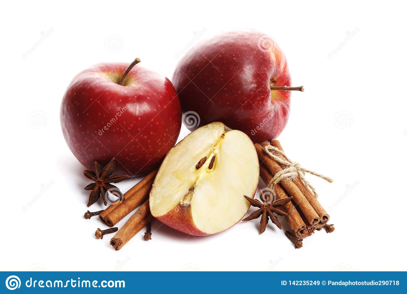 Juicy ripe apples with cinnamon and star anise isolated on white background