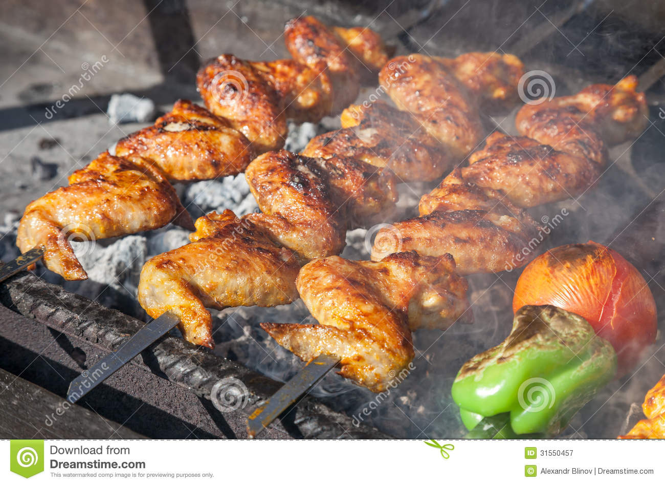 Juicy slices of meat prepare on fire