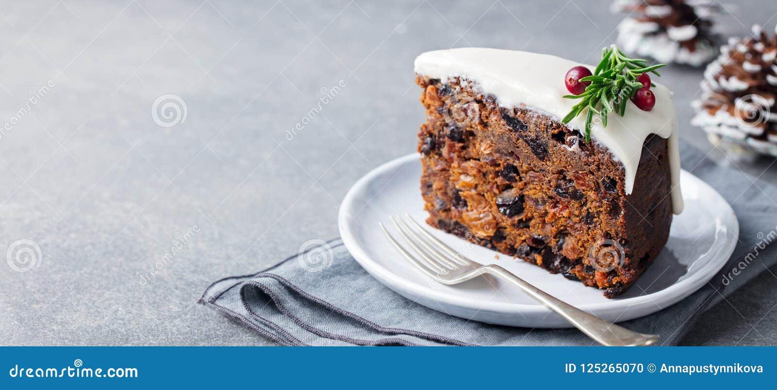 Jul bär frukt kakan, pudding på den vita plattan kopiera avstånd