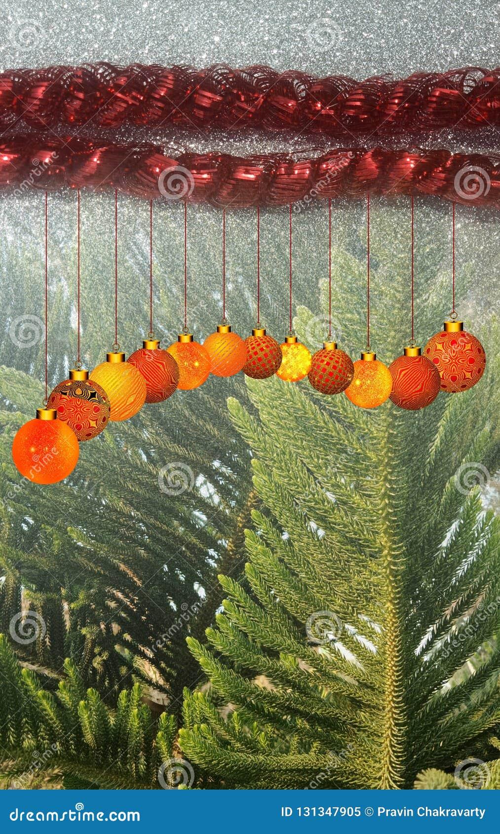 Julbakgrund med den röda och gula prydnaden på en svart blänker texturerad bakgrund