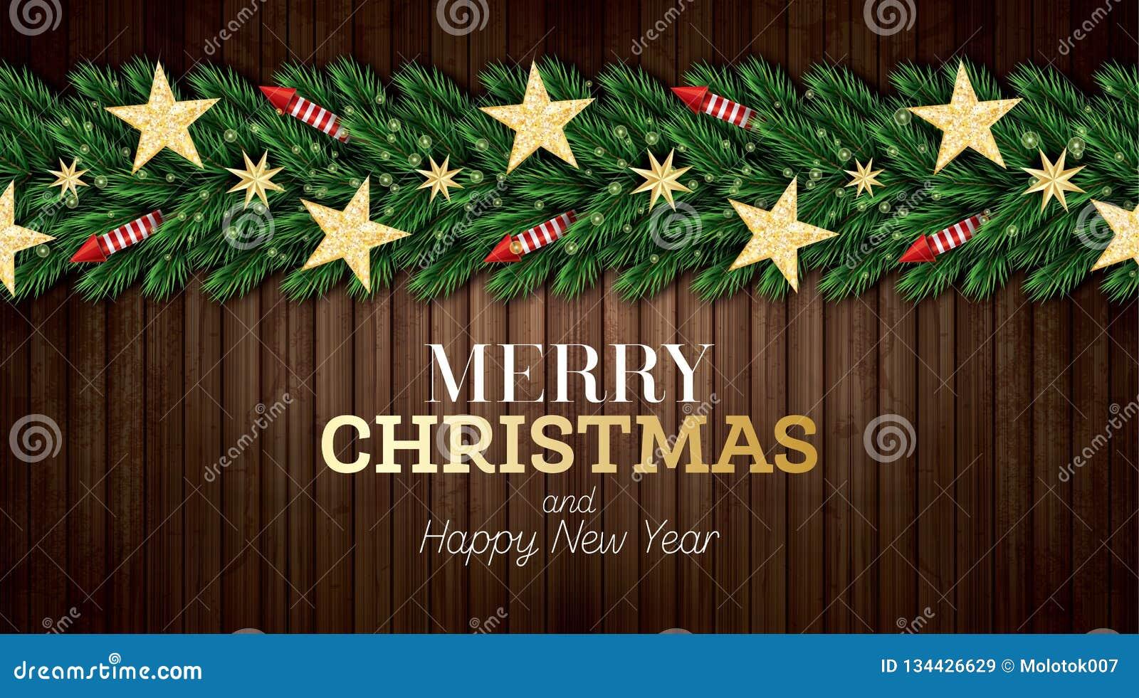Julhälsningkort med julgranfilialer, röda raket och guld- stjärnor på träbakgrund