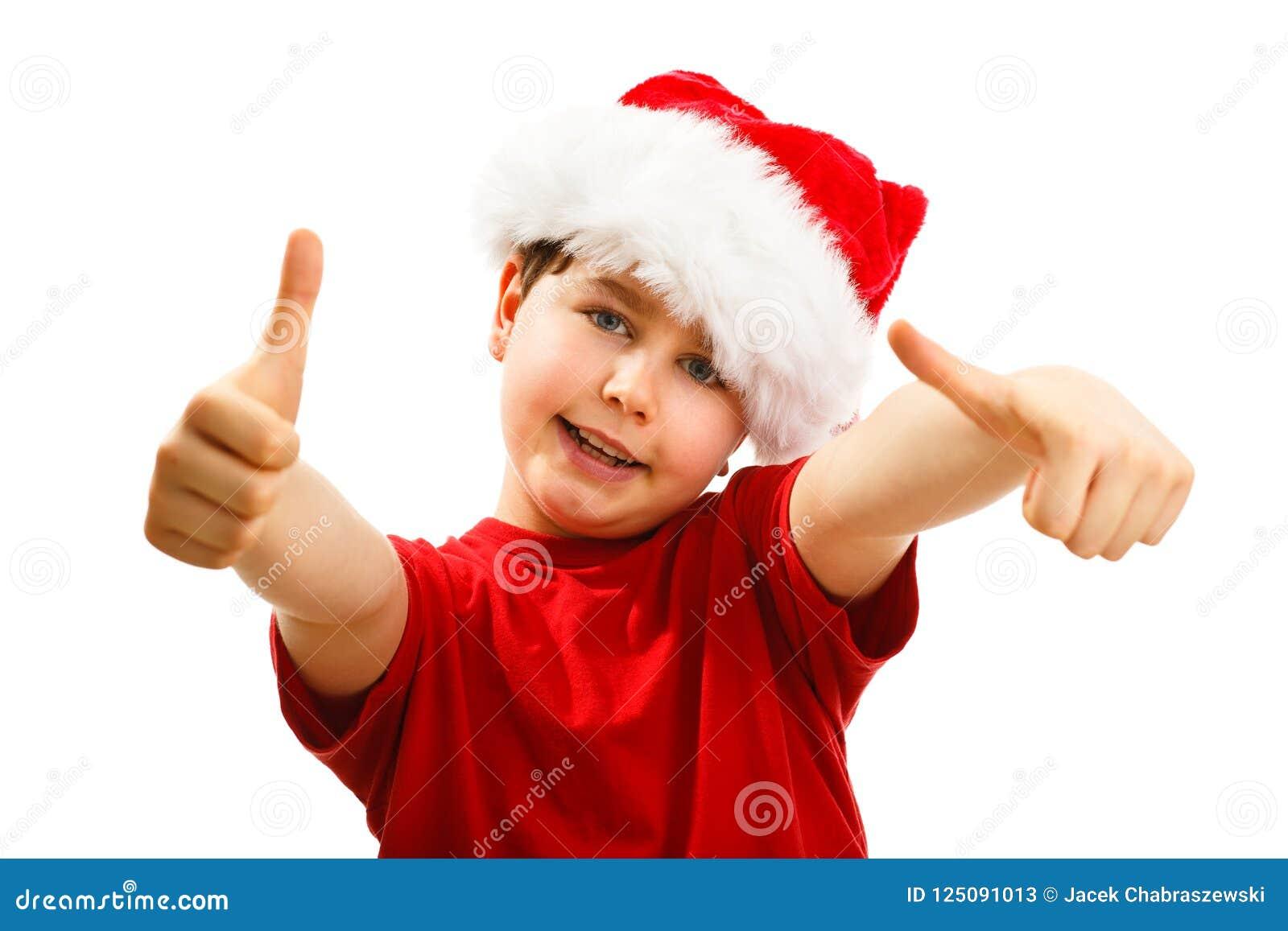Jultid - pojke med Santa Claus Hat som visar det ok tecknet