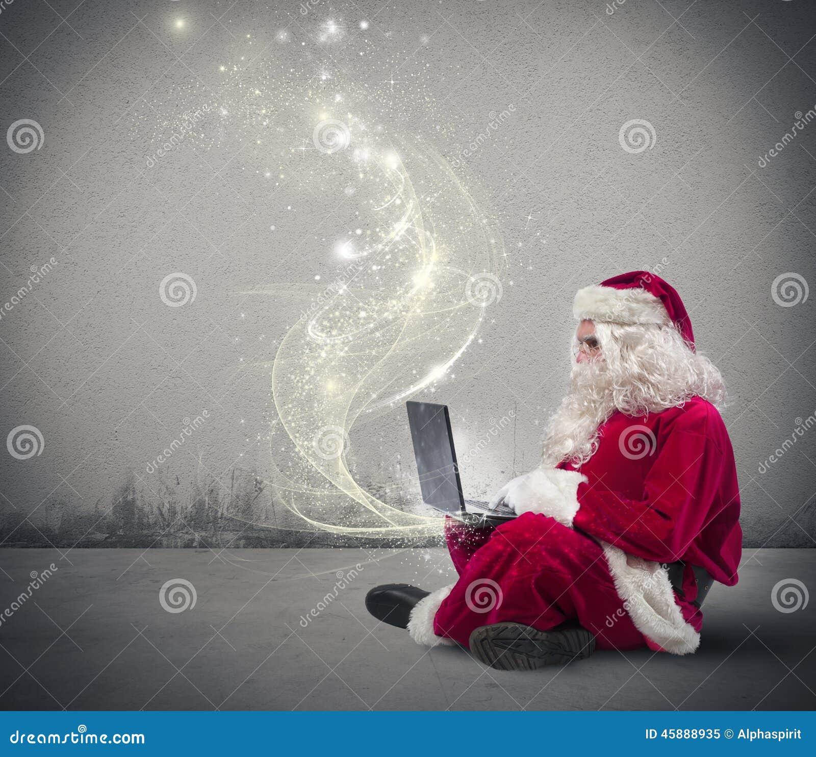 Jultomte med bärbar dator