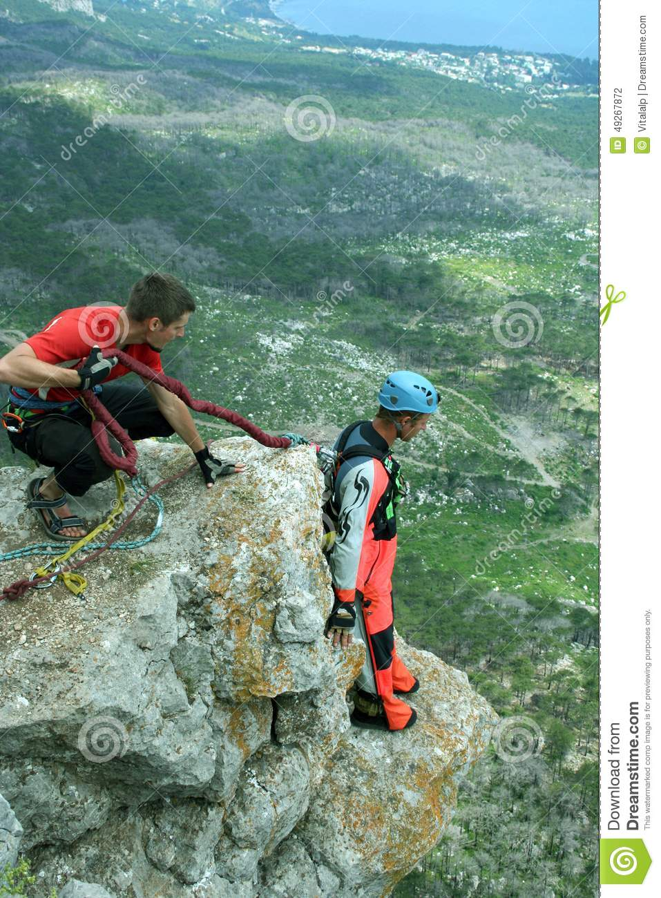 Jump Off A Cliff With A Rope Bungee Jumping Stock Photo