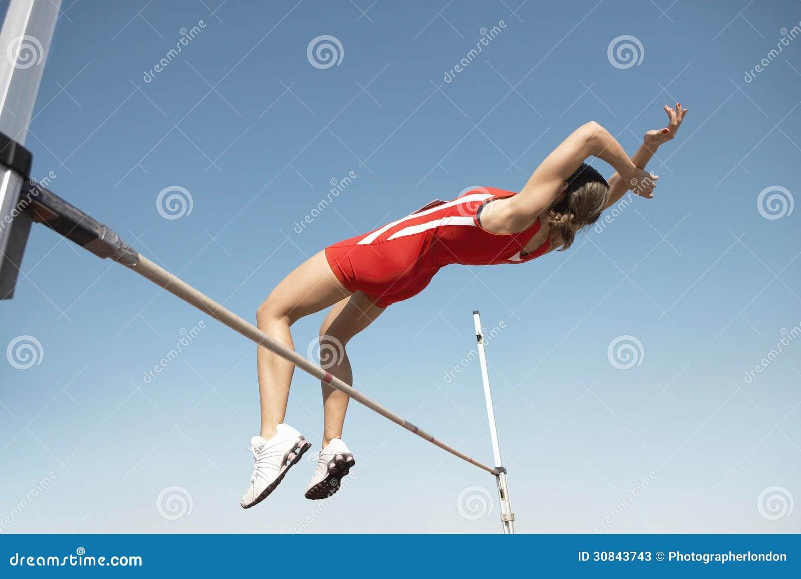 Jumper In Midair Over Bar alto