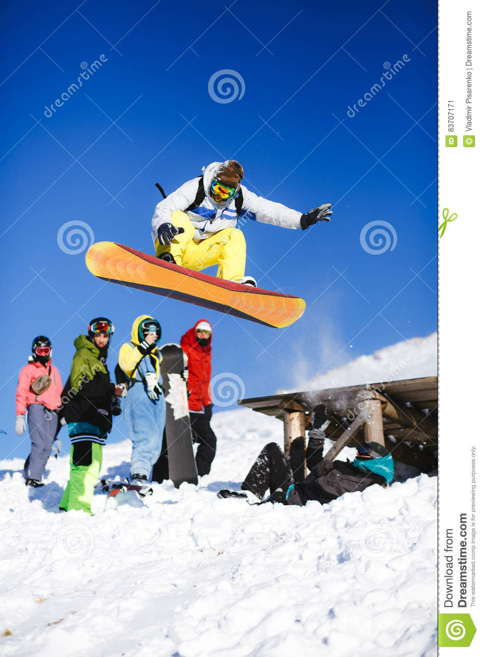 Jumping Snowboarder On Blue Sky Background Stock Photo