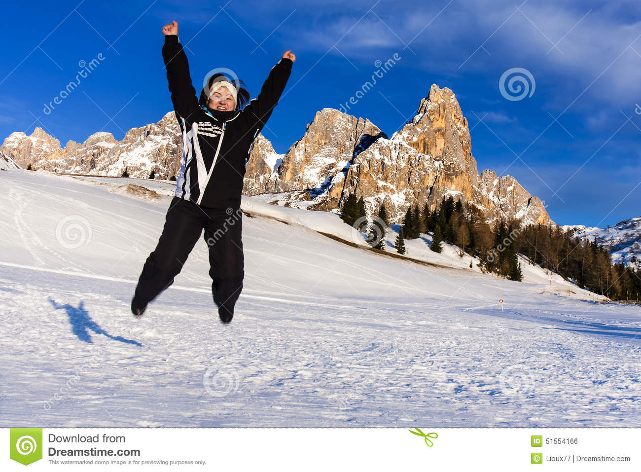 Jumping woman snow mountain happiness vacation stock photo for Vacation in the snow