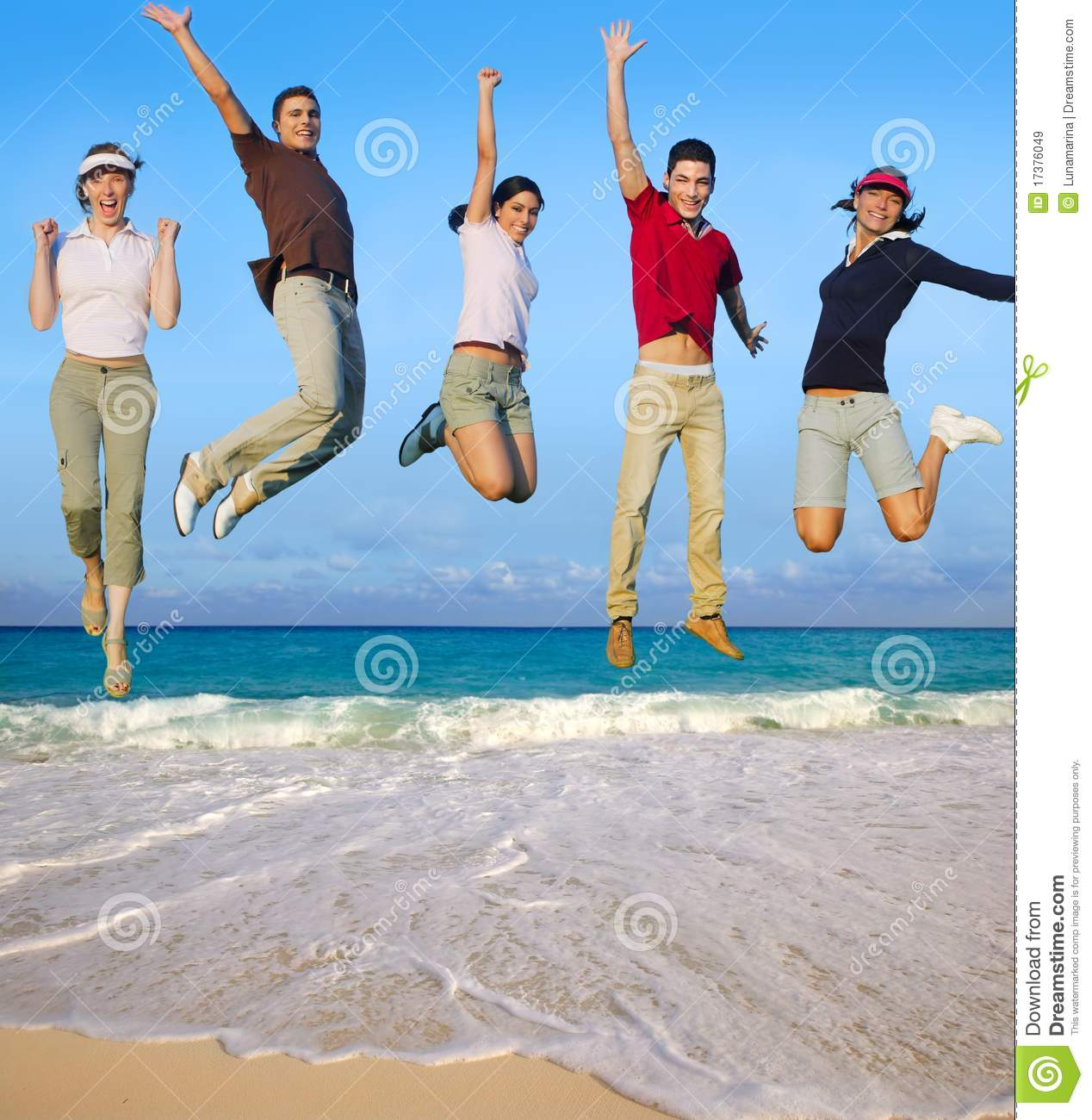 Jumping Young People Happy Group Tropical Beach Stock