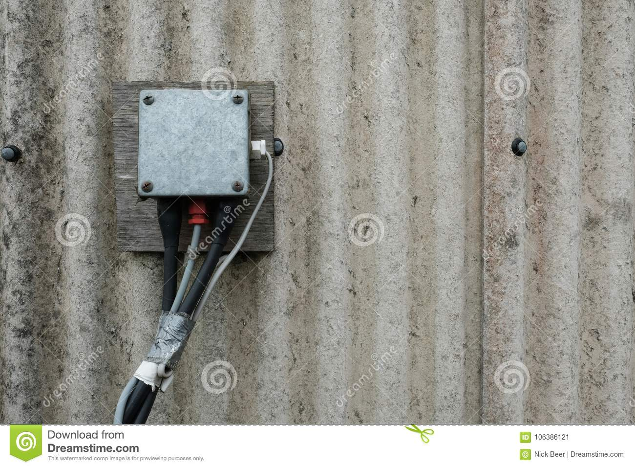 Detail Of An Electrical Junction Box And Wiring Seen On Asbestos Clad Shed