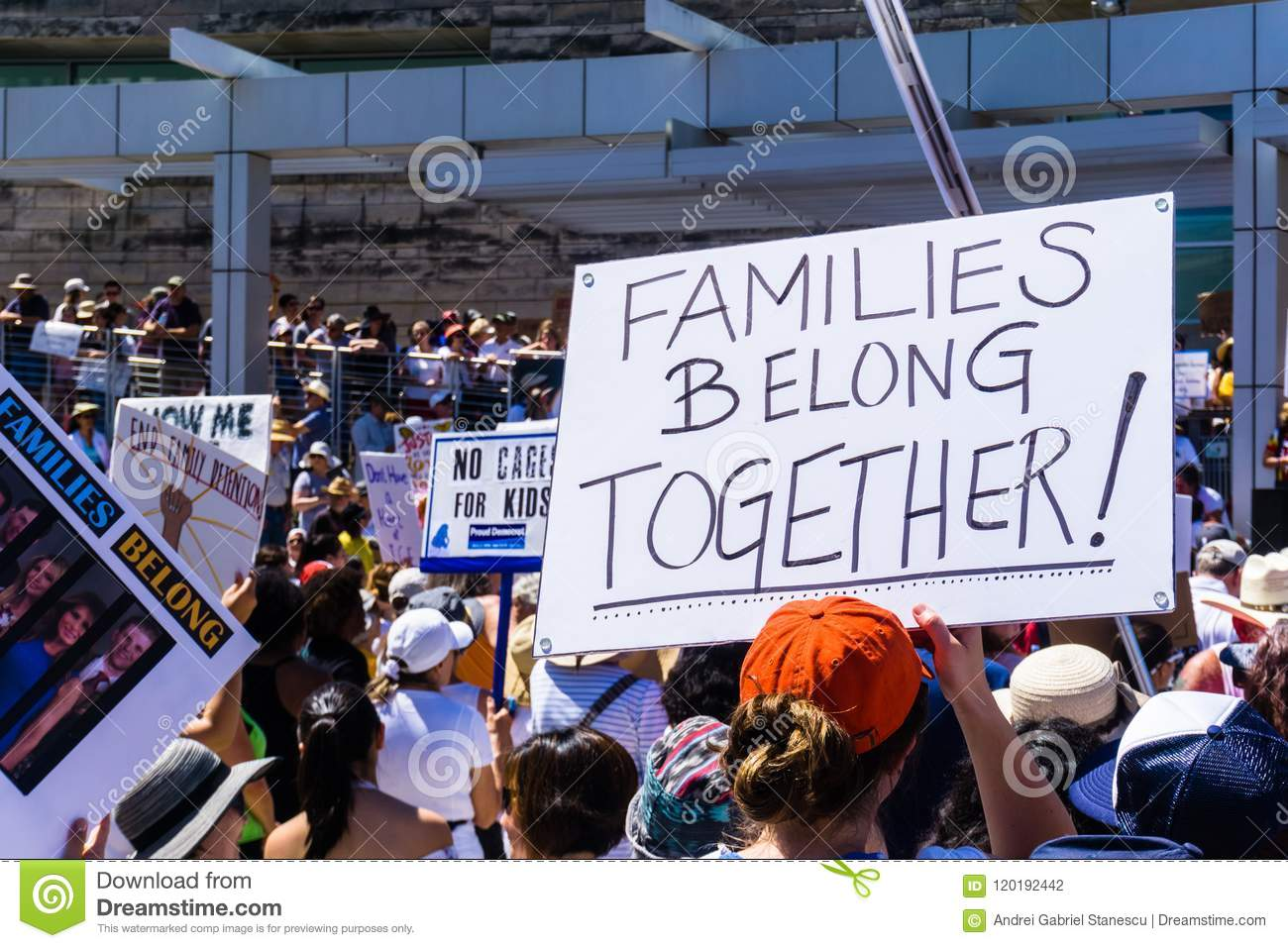 People gathered in front of the San Jose City Hall for the `Families belong together` rally