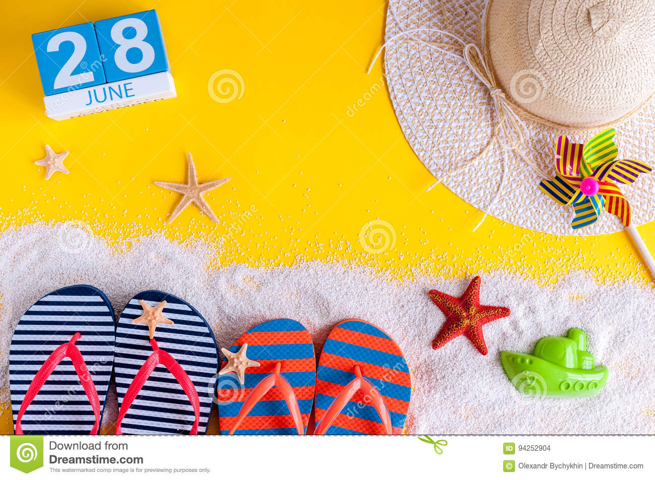 June 28th. Image of june 28 calendar on yellow sandy background with summer beach, traveler outfit and accessories