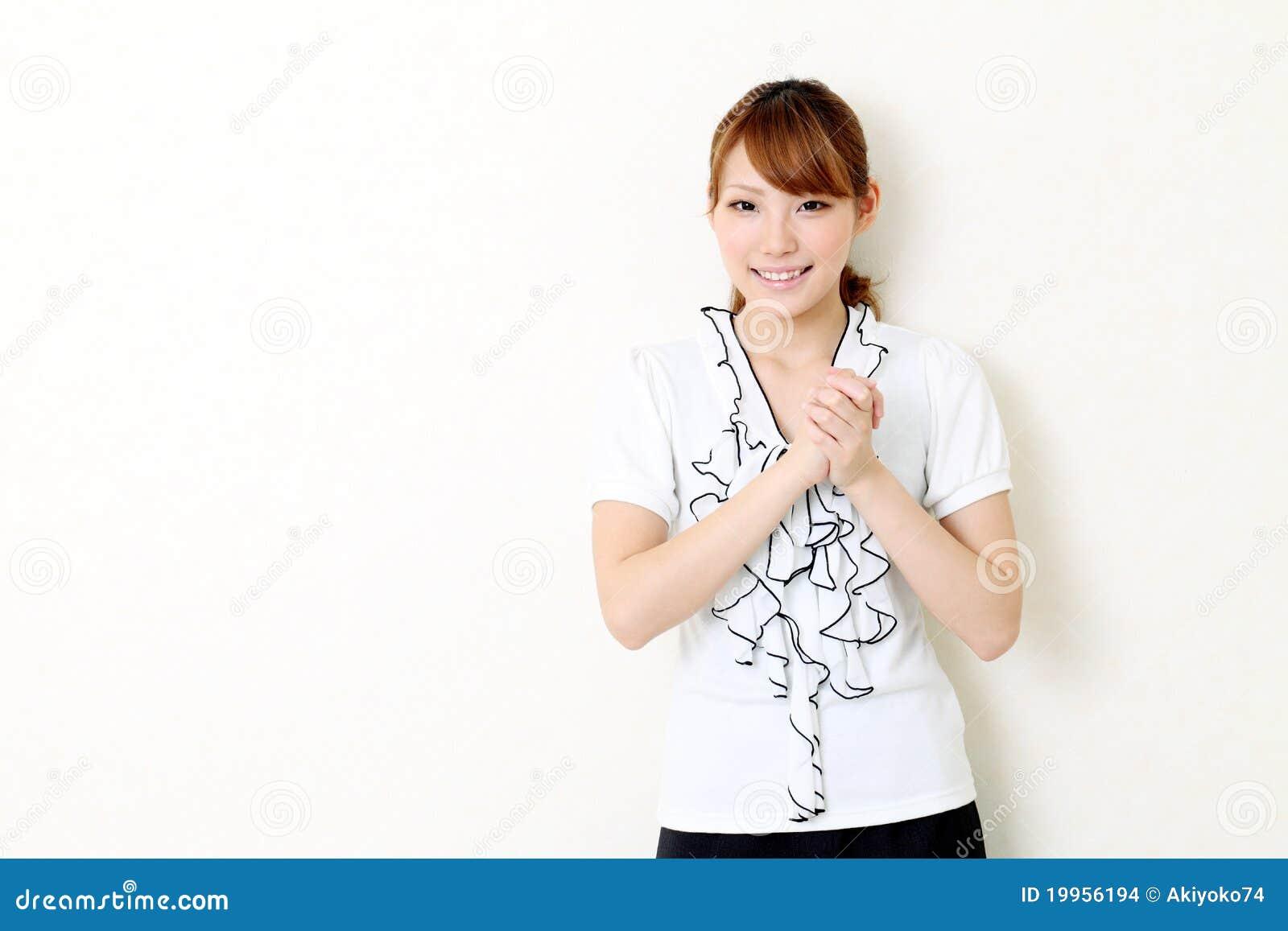 Junge Asiatische Geschäftsfrau Mit Ihren Händen Umklammert Stockfoto ...