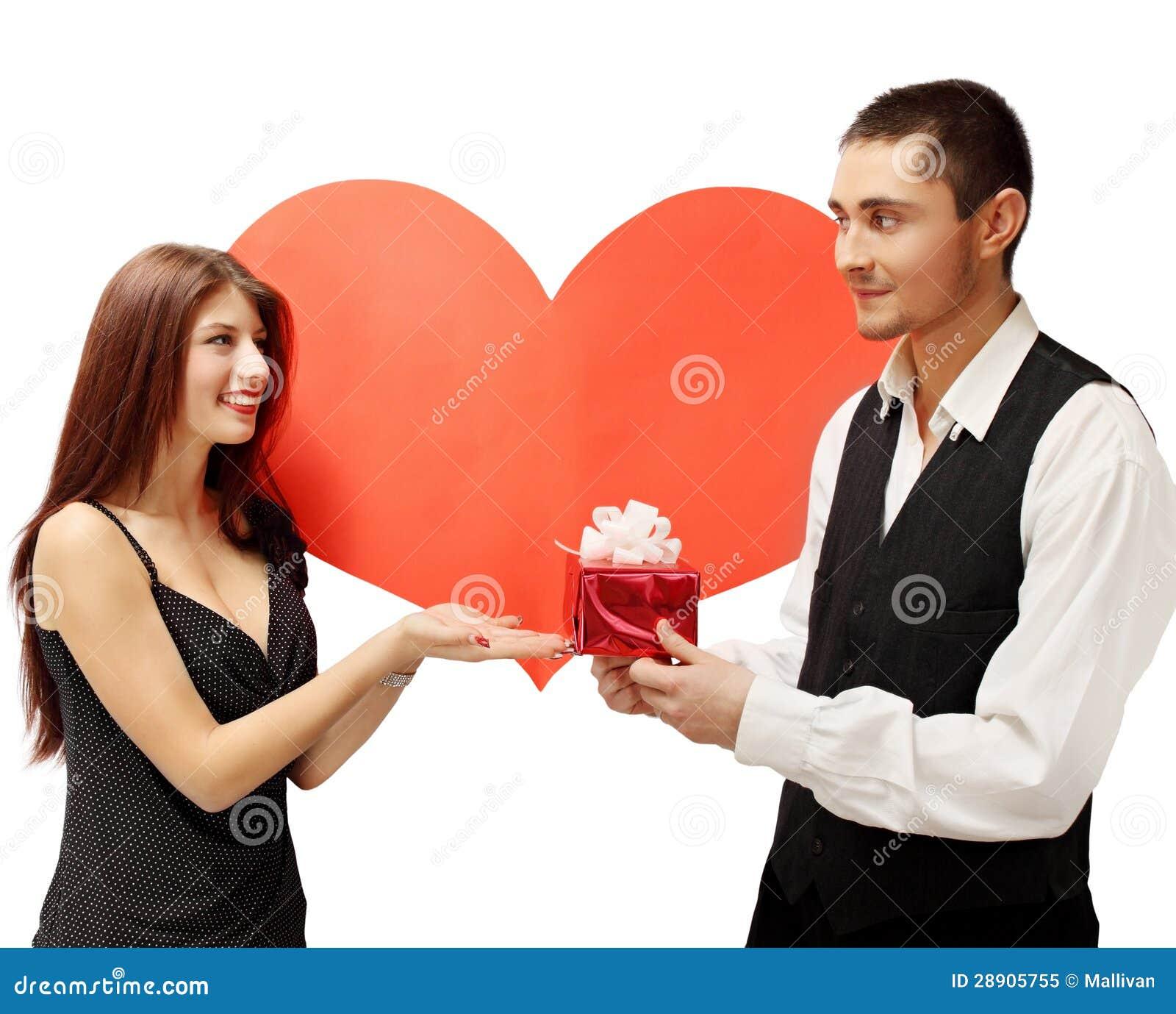 Junge Paare Mit Einem Geschenk Stockbild - Bild von verbunden ...