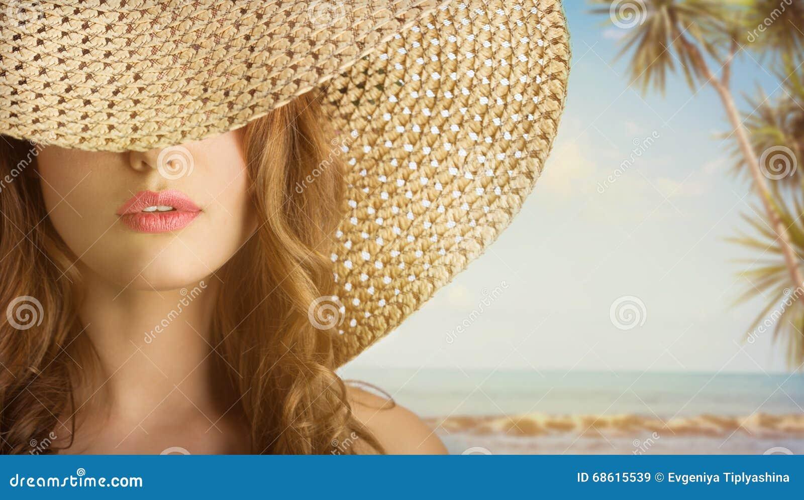Junge Schönheit mit einem Hut