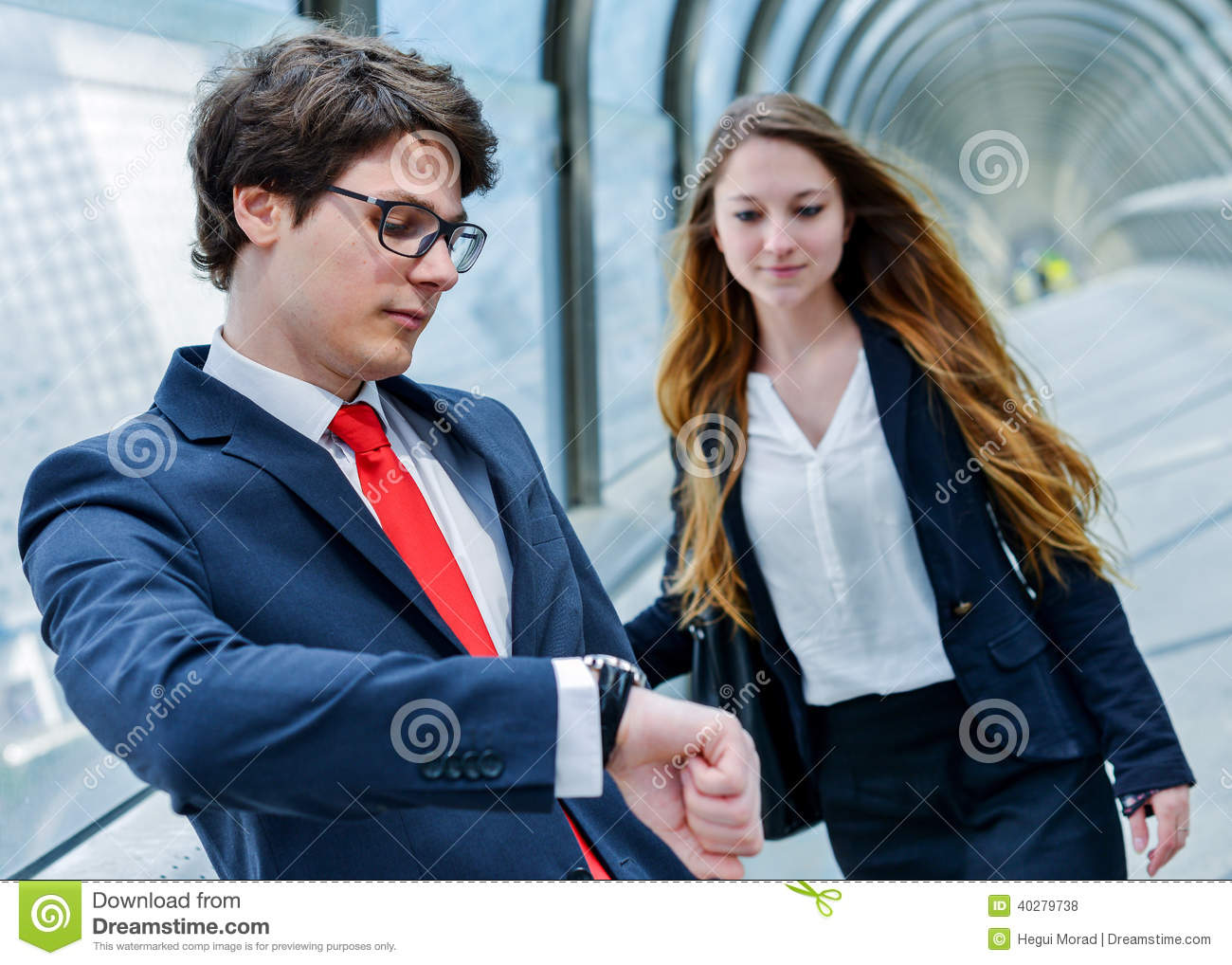 Junior executives of company are late for a business meeting