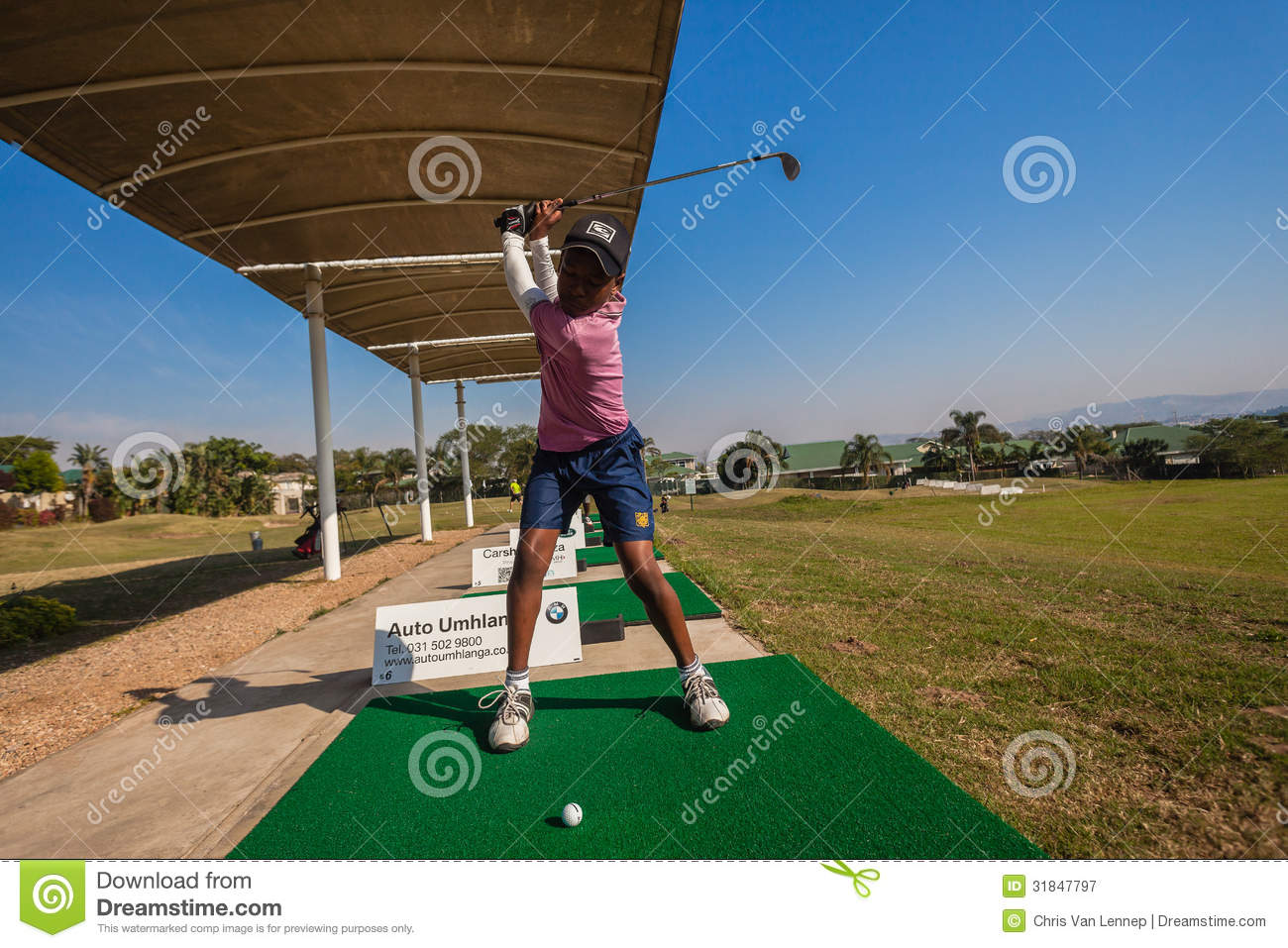 Junior Player Golf Practice Swinging