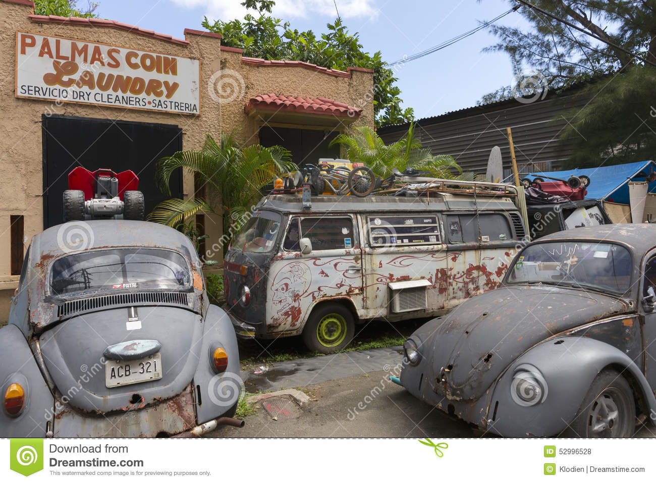 Junk yard with old Volkswagen cars.