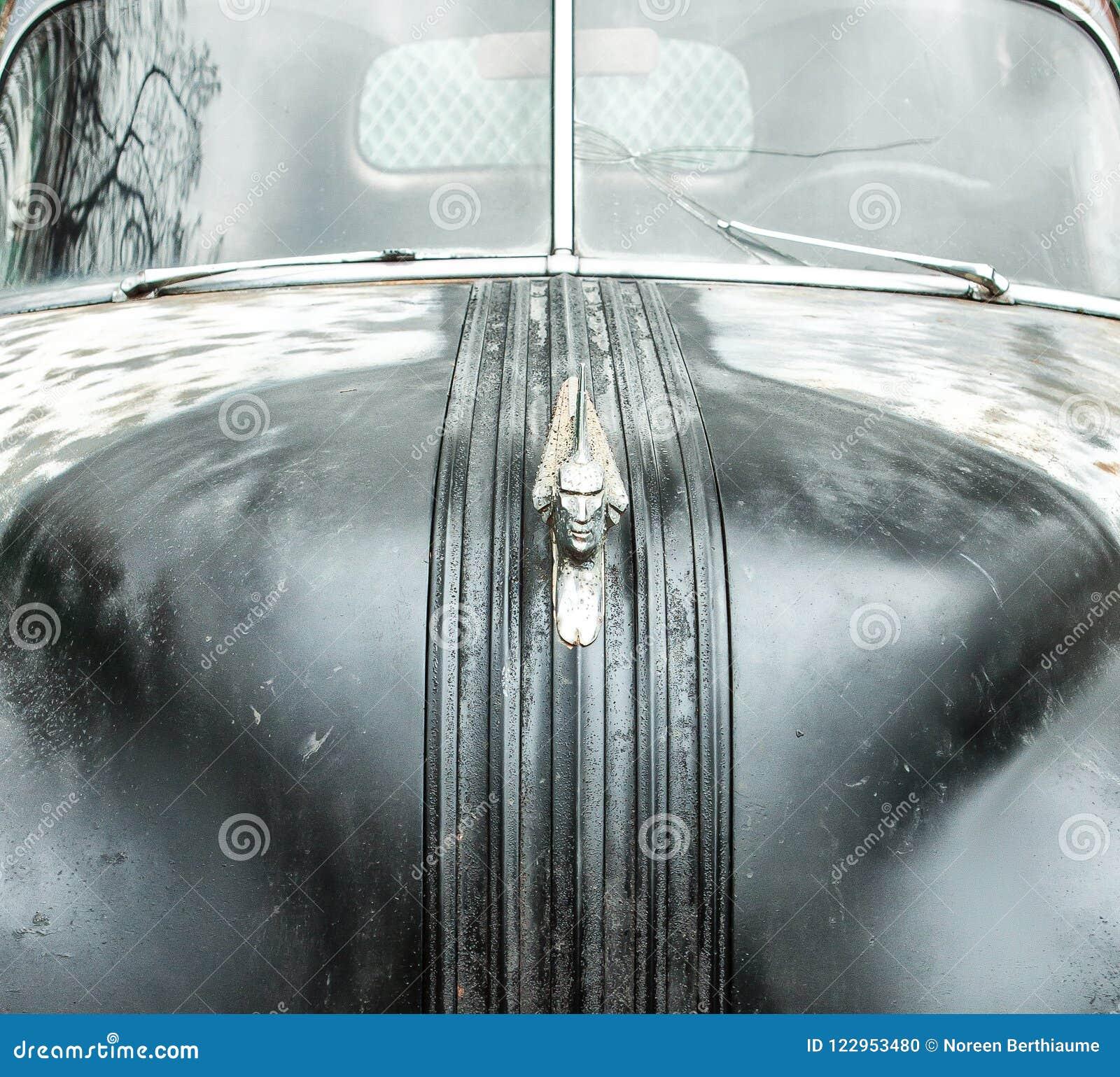 Junkyard Abandoned Pontiac Car Hood Ornament Stock Photo