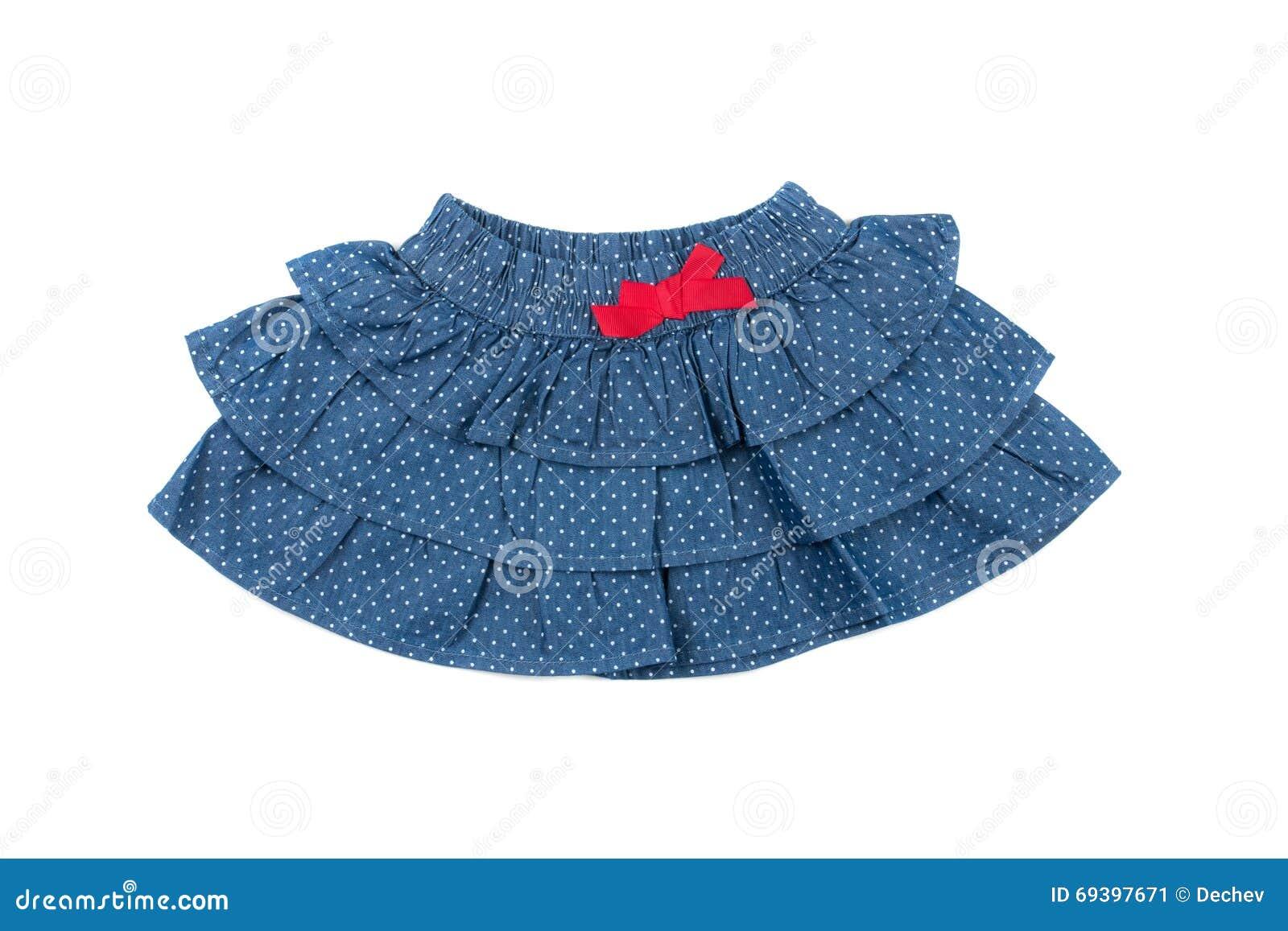 Jupe bleue d enfants avec les points blancs, d isolement sur le blanc